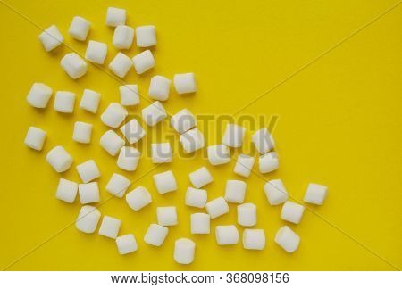 Marshmallows On Yellow Background With Copyspace. Flat Lay Or Top View. Background Or Texture Of Col