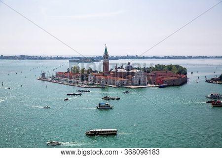 Island And Church Of San Giorgio Maggiore, Heavy Ship, Boat And Vaporetto Traffic In Venetian Lagoon