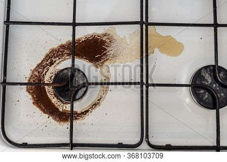 Dirty Enamel Stove With Two Coffee Burners Close Up