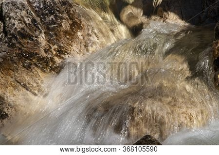 Watercourse In The Dolomites With Water And Rocks