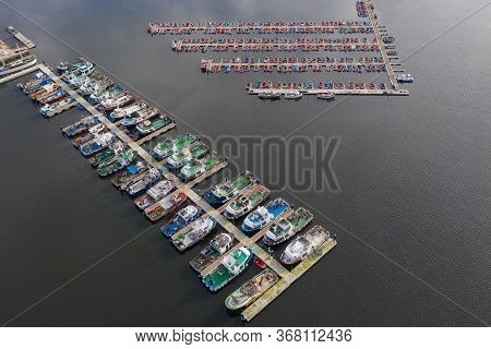 Fishing Boats On The Pier In The Port Aerial View