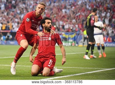 Madrid, Spain - June 1, 2019: Mohamed Salah Of Liverpool Celebrates With Jordan Henderson Of Liverpo