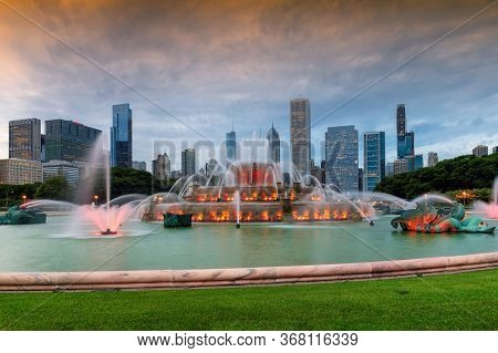 Chicago City Skyline At Twilight With Skyscrapers And Buckingham Fountain, Chicago, Illinois, Usa.