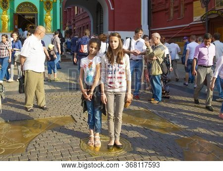 Moscow, Russia - July 01 2015: Two Teenage Girls Standing At Kilometer Zero Famous Travel Destinatio