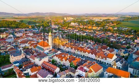 Aerial view to historic center of Domazlice city in sunset. Medieval town was first recorded as a town in 1231. Beautiful destination in Western Bohemia. Czech Republic, Central Europe.