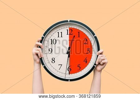Womens Hands Hold A Round Black Watch, Showing Half An Hour. Dial And Hands. Lunch Break, Meeting, O