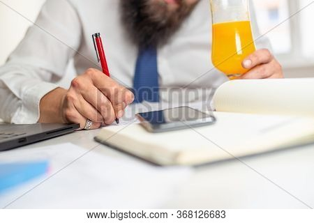 Businessman Hand Signing Document. Close Up Of Businessman Signing Contract Document. Business Peopl