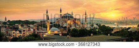 Illuminated Hagia Sophia And Beautiful Sunset In Istanbul, Turkey