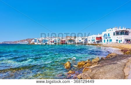 Panoramic view of the beach and houses by the sea in Mykonos Island in Greece