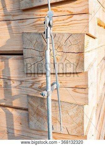 Log Wall Of Modern Wooden House Under Construction. Detail Of Lightning Conductor, Wire Lightning Co
