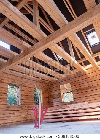 Wooden House Construction. Wooden Roof Frame Above House. Theme Of Healthy Housing, Services Of Hous