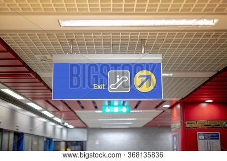 The Blue Exit Sign For Show The Way To Exit To Passenger That Travel With The Subway Station.