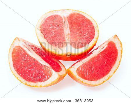 Slices Of Grapefruit Isolated On White Background