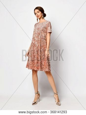 Full Length Shot Of Glamour Young Woman With Stylish Hairdo And Thick Earrings Demonstrating Sparkly