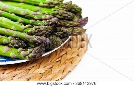 Bunch Of Fresh Raw Asparagus On White Background, Vegetarian Concept. Green Grass Sparrowgrass Stick