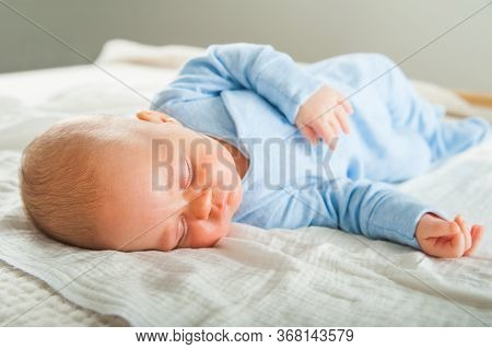 Newborn Sleeping Close Up. Baby Is Sleeping Soundly On The Bed And Copy Space. Infant Care, Colic, S