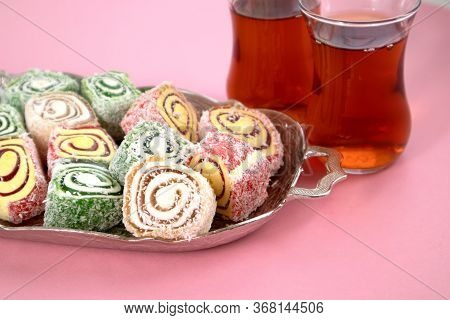Turkish Delight And Tea On A Metal Tray On A Pink Table. Selective Focus
