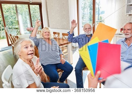 Seniors do an exercise in group psychotherapy at the retirement home