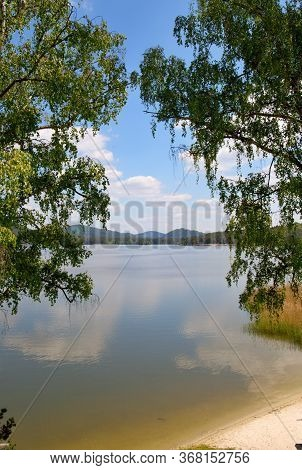 Reflections On The Surface Of Macha Lake, Czech Republic, Alley, Aquatic Plants, Blue Sky With White
