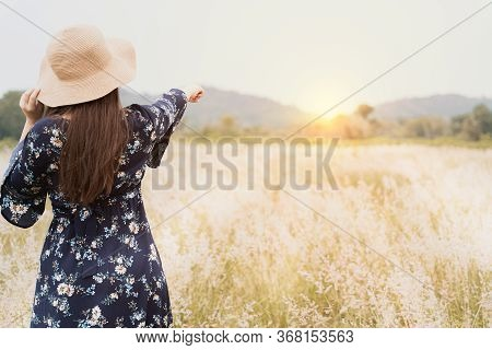 Summer Portrait Of Young Hipster Woman Standing In Meadow On Sunny Day.young Slim Beautiful Woman, B