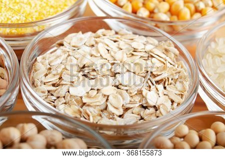 Rolled Oat Flakes Closeup In Glass Bowl On Wooden Kitchen Table, Non-perishable, Long Shelf Life Foo
