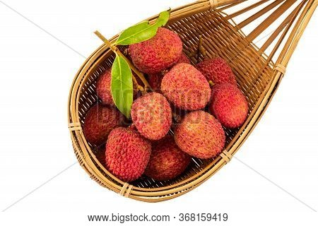 Ripe Lychees With Green Leaves In Basketwork Isolated On White Background With Clipping Path.