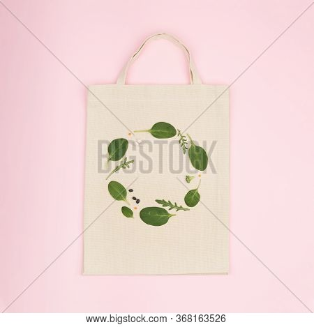 Canvas Eco Bag With Creative Green Composition Made Of Green Spinach Leaf, Rucola And Bean . Flat La