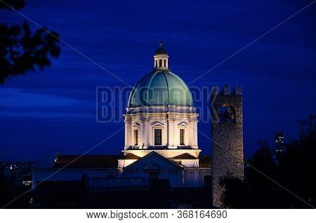 Dome Of Santa Maria Assunta New Cathedral, Duomo Nuovo Roman Catholic Church And Tower Of Palazzo De
