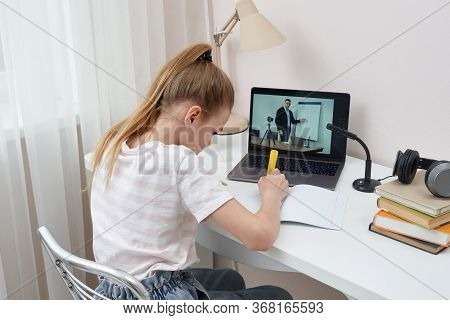Teenage Girl Studying Via Video Conference, E-learning With Teacher And Classmates On Computer At Ho