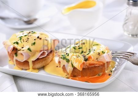 Breakfast. Best Eggs Benedict - Fried English Bun, Ham, Poached Eggs And Delicious Hollandaise   But
