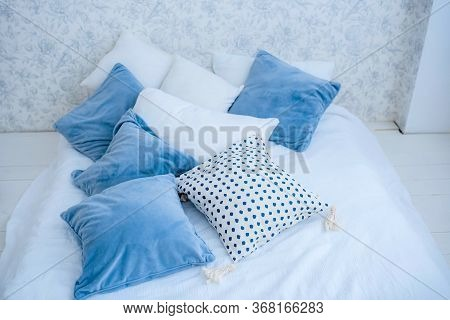White And Blue Pillows, On A Bed. White Bed Linen. Bedroom With Bed And Bedding.