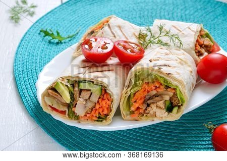 Fresh Tortilla Wraps With Chicken, Mushrooms And Fresh Vegetables. Chicken Mexican Burrito. Tasty Ap