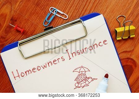 Homeowners Insurance Phrase On The Piece Of Paper.