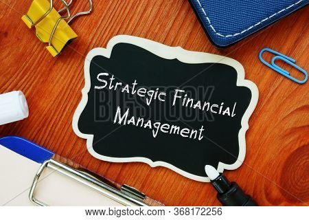 Financial Concept Meaning Strategic Financial Management With Sign On The Sheet.