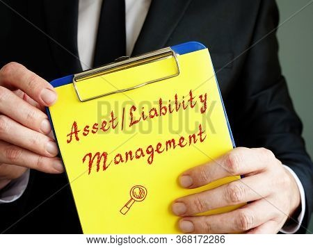 Business Concept Meaning Examples Of Asset/liability Management With Sign On The Piece Of Paper.