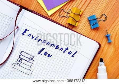 Business Concept Meaning Environmental Law With Phrase On The Sheet.