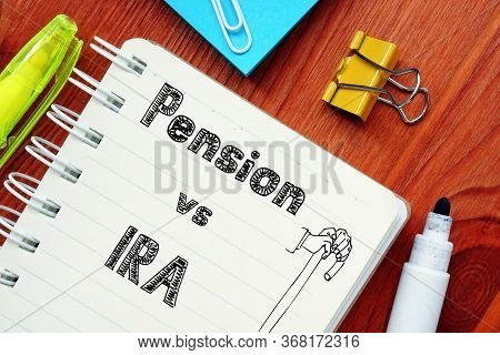 Business Concept About Pension Vs Ira With Phrase On The Sheet.