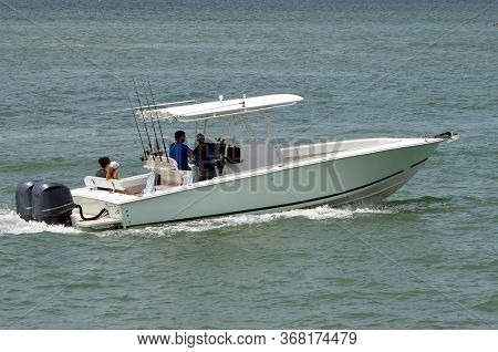 Open Sport Fishing Boat With Canopied Center Console Cruising On The Florida Intra-coastal Waterway