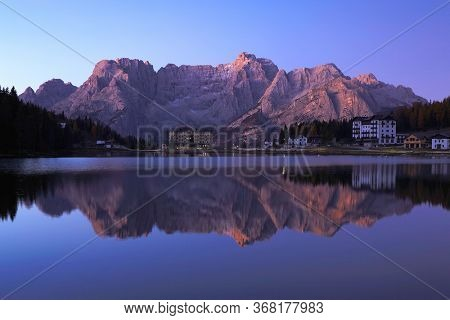 Early morning light over Sorapis Lake in late autumn, Dolomites, South Tyrol, Italy