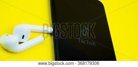 Rome Italy, April 24, 2020. Tiktok Logo On The Screen Iphone With Earpods, Tiktok Is App To Create A