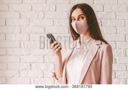 Portrait Beautiful Happy Female Entrepreneur In Stylish Medical Face Mask And Suit Using Smart Phone