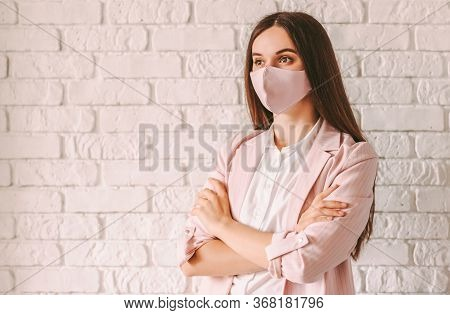 Portrait Young Confident Professional Business Woman In Pink Suit And Medical Face Mask With Arms Cr