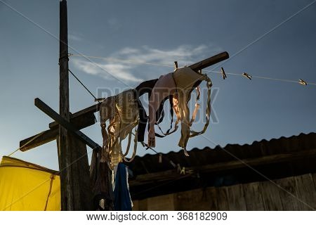 Mabul Island, Sabah, Malaysia - August 08, 2018: The Bras Hanging In Front Of The House. The Beautif