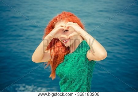 Love For Travel. Closeup Portrait Smiling Happy Young Woman Making Heart Sign, Symbol With Hands Iso