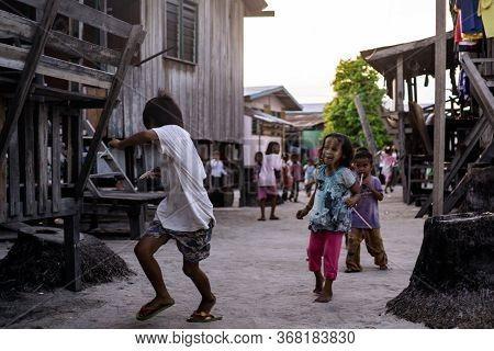 Mabul Island, Sabah, Malaysia - Aug 08, 2018: A Happy Face And Enjoy Of The Kids Life On Mabul Islan