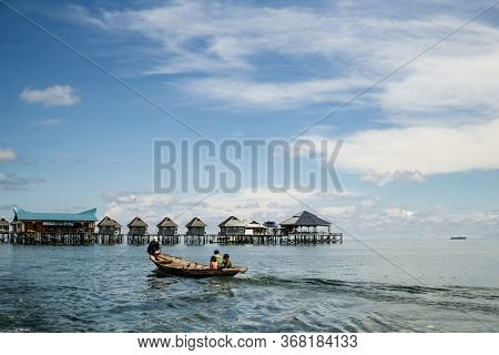 Mabul Island, Sabah, Malaysia - August 08, 2018: A Silhouetted Family Of