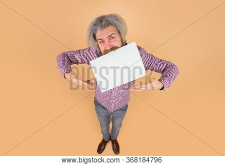 Sale. Discount. Advertising. Happy Man With Blank Board In Mouth. Bearded Man Shows Empty Board. Spa