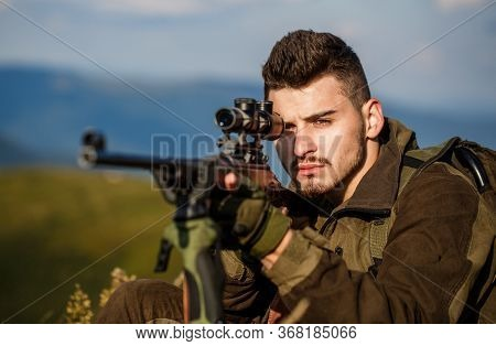 Hunt Hunting Rifle. Hunter Man. Shooter Sighting In The Target. Hunting Period. Male With A Gun. Clo