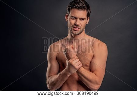 Handsome Young Bearded Man Isolated. Cropped Image Of Topless Muscular Man Is Standing On Gray Backg