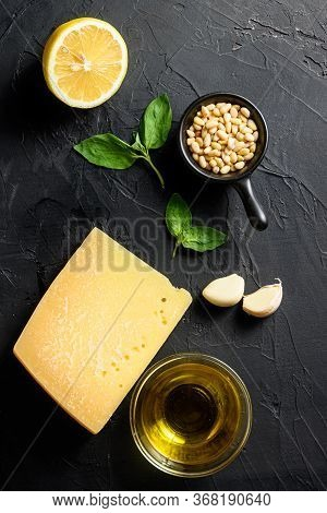 Pesto Alla Genovese , Fresh Ingredients For Pesto Genovese Sauce On Black Stone Background From Abov